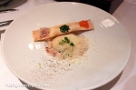 Fresh crab meat on edamame beans with slightly cooked egg, grissini bread, salmon roe, Parmesan
