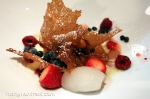 Caramel crisp with wild ginger sorbet, ice cream, fruit syrup, and berries